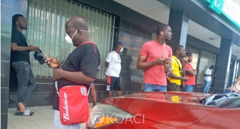 Côte d'Ivoire : Coronavirus, 2è jour du couvre-feu, à Yopougon de longues files devant les banques, psychose d'une crise