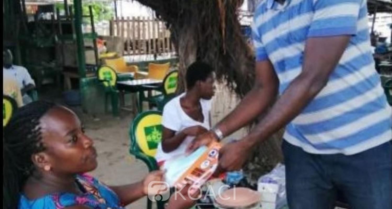 Côte d'Ivoire : Coronavirus, à Yopougon, joie d'ouverture de maquis et bars, distribution de masques alternatifs