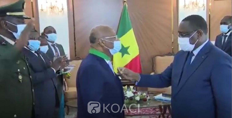 CEDEAO : L'Ivoirien  Jean Claude Kassi Brou élevé au rang de Commandeur dans l'Ordre National du Lion par le Président Macky Sall